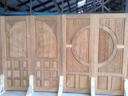 ประตูไม้สักแกะลาย - บริษัท ซิ้มย่งหลี ทิมเบอร์ กรุ๊ป จำกัด